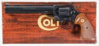 COLT PYTHON IN SCARCE .38 SPECIAL, COLT BLUE FINISH AND 8 INCH VENT RIBBED BARREL. WOOD GRAINED BOX AND PAPERS.