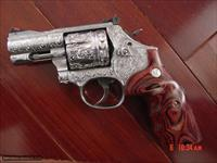 Smith & Wesson 686-6 Plus,fully engraved & polished by Flannery Engraving,certificate,rosewood grips,box,manual,etc. way nicer in person. a work of art with 2 1/2