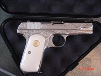 Colt 1908 380auto, master engraved & refinished nickel by S.Leis,bonded ivory grips,certificate,made 1925,a rare work of art-nicer in person-awesome !!