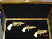 North American Arms-rare Golden Eagle 3 gun set,24K plated,in fitted case,pearlite grips,22S,22LR,22Mag,matching serial #s,much nicer in person- never seen one before !!