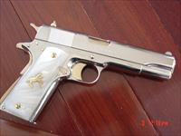 Colt Government 1911,45acp, fully refinished in bright nickel with 24K gold accents,2 mags,custom Pearlite grips,box,manual & never fired-awesome showpiece !!