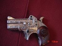 Bond Arms-Derringer,410/45 Colt,fully engraved & polished by Flannery Engraving,dark Rosewood grips,Cowboy Defender model,with box & papers etc.1 of a kind hand cannon -awesome !!