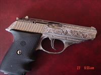 Sig - Sauer P230, 380,2 mags,fully engraved & polished by Flannery Engraving,Germany,with certificate, double or single action,Hogue grips,awesome showpiece !! finished 12-21-2017