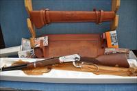 Model 94 John Wayne Commemorative 32-40, leather scabbard and tooled rifle rack
