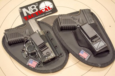 The N82 Tactical Professional (left) and Tuckable (right) holding a pair of Springfield Armory XD-S pistols.
