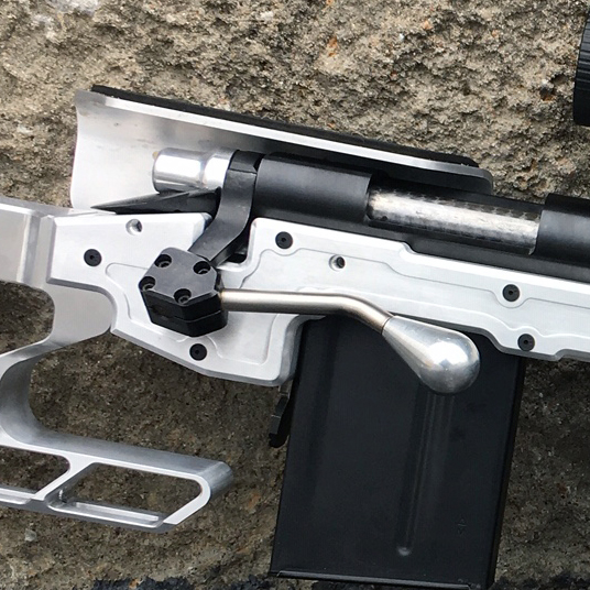 the bolt extension can be seen up close here. This add on that is included with the chassis brings the bolt handle further forward and closer to the shooter's reach.
